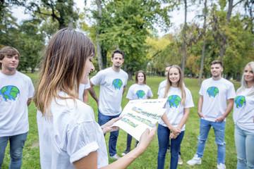 Teenage volunteers doing garbage cleanup in park