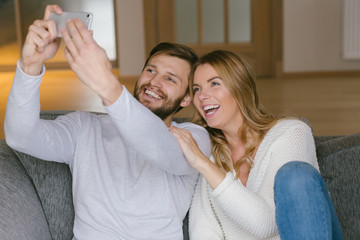 Smiling wide couple posing for selfie