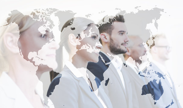 Business team with world map, double exposure