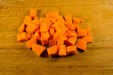 Chopped carrot on a wooden table