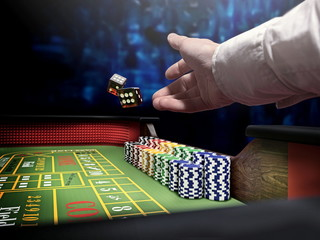 dice throw on craps table at casino
