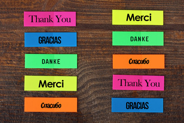 The word Thank you in different languages. The word Thank you written in multi-colored stickers.