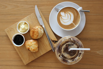 Coffee with Leaf Art with Scones and Jam
