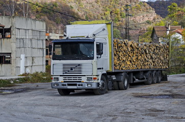 Big lorry carry stack firewood in Lakatnik, Bulgaria