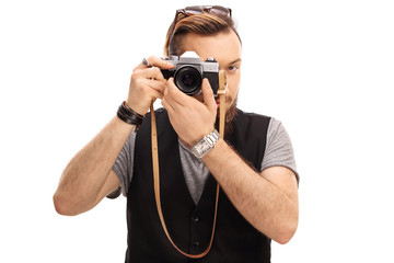 Hipster taking a picture with a camera