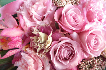 Pink roses in flower arrangement