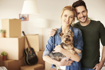 Portrait of couple with small pet