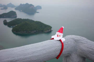 Santa Claus hair band on the viewpoint of Ang thong archipelago island.Thailand.