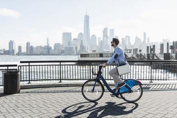 Man riding bicycle at promenade, New Jersey, New York, USA