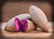 Purple Sweet Potatoes on a wooden table