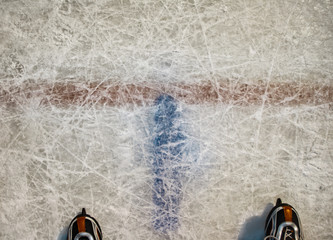 Figured hockey skates on ice background