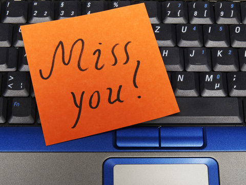 Memo note on notebook, miss you