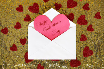 Envelope with Valentine's Day Heart Note and Confetti on Gold Se