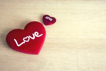 heart on wooden ground