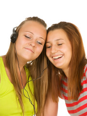 Two teenage girls listening to music on your mobile phone