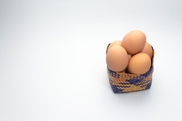 egg in basket on white background