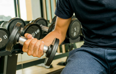 a man is exercise in the gym with dumbbell