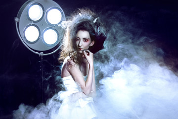 Young attractive girl as a Ghost, a lot of smoke, hospital lamp in the background. Dark Gothic image, creative style