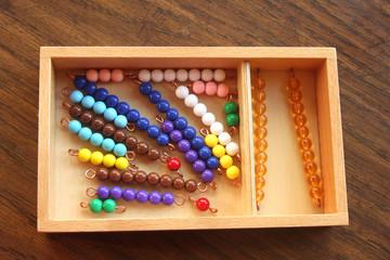 Wooden Box Holding Montessori Bead Manipulatives