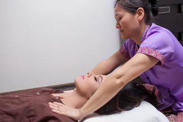 Masseur doing massage to caucasian woman in the spa salon