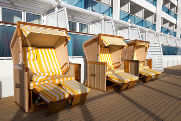 Hooded beach chairs on deck of a cruise ship.