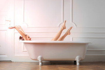 Girl streching in bathtub