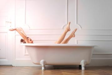 Girl streching in bathtub