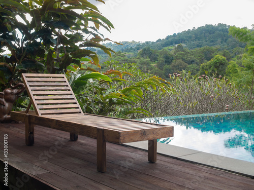 Wooden pool chair at the resort with beautiful landscape for Pool garden mountain resort argao