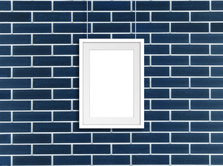 White frame hanging on cords against navy blue decorative bricks wall. Gallery style decor mock up