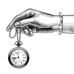 Woman's hand with a retro pocket watch