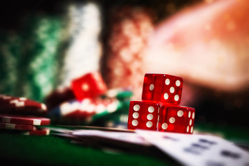 Poker Chips in casino gamble green table, dark vintage picture s