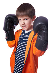Small boy with boxing gloves isolated on white is ready to fight.