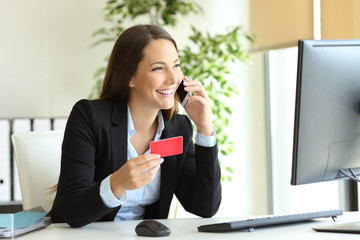 Businesswoman buying online and calling customer service