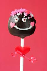 Funny girl cake pops on pink background