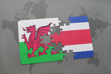 puzzle with the national flag of wales and costa rica on a world map