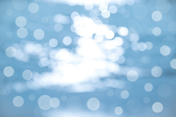 Blurred sea texture, blue Bokeh sea as background