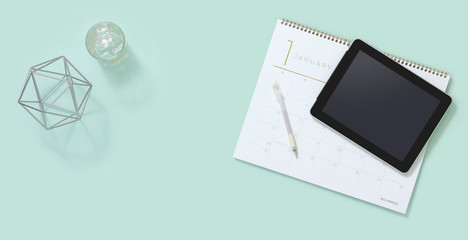 Office desk with daily planner and tablet pc