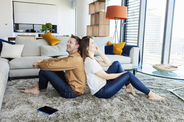 Couple relaxing in modern apartment
