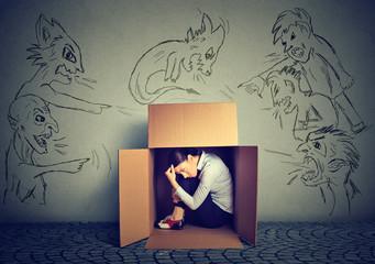 Bad evil men pointing at woman. Girl hiding inside box