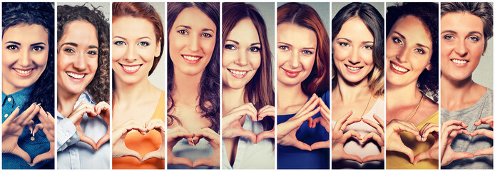Multiethnic group of happy women making heart sign with hands