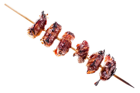 Bacon wrapped dates skewer isolated