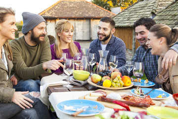 Group of friends enjoying party outdoors