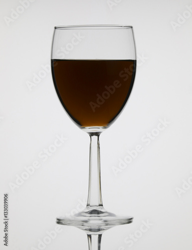 Tall Wine Glass With Colored Liquor On White Background