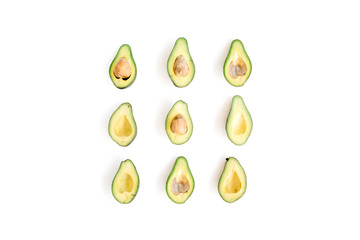 Sliced raw avocado arrangement. Flat lay, top view. Creative food concept