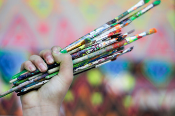 Human hand holding art brushes