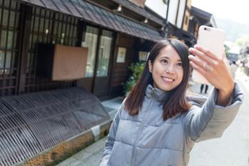 Woman taking selfie when travel in Japan