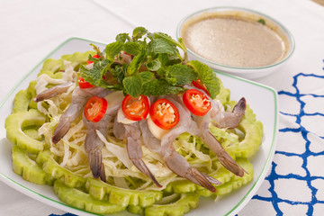 A Thai style dish of raw sea prawn served with cabbage and bitter cucumber and mint in spicy sauce.