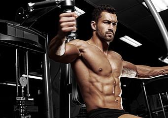 Bodybuilder posing in the gym