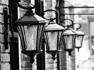 Black and white image of a brightly lit Lamp post against a text