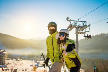 Young couple is skiing in mountains